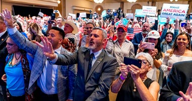 Supporters react as President Donald Trump speaks at a Latinos for Trump Coalition roundtable at Arizona Grand Resort & Spa, Monday, Sept. 14, 2020, in Phoenix. (AP Photo/Andrew Harnik)