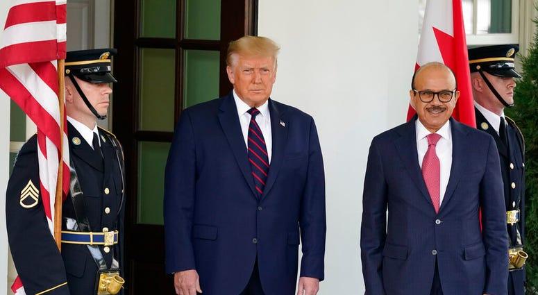 President Donald Trump greets the Bahrain Foreign Minister Khalid bin Ahmed Al Khalifa at the White House, Tuesday, Sept. 15, 2020, in Washington. (AP Photo/Alex Brandon)