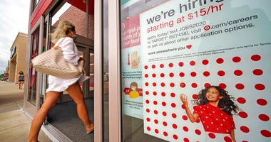 In this Sept. 2, 2020, file photo, a help wanted sign hangs on the door of a Target store in Uniontown, Pa.  (AP Photo/Gene J. Puskar, File)