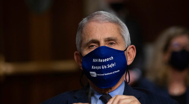 Dr. Anthony Fauci, Director of the National Institute of Allergy and Infectious Diseases at the National Institutes of Health, listens during a Senate Senate Health, Education, Labor, and Pensions Committee Hearing.  (Graeme Jennings/Pool via AP)