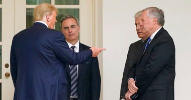 President Donald Trump  outside the Oval Office of the White House after visiting the Supreme Court to pay respects to Justice Ruth Bader Ginsburg, Thursday, Sept. 24, 2020, in Washington. (AP Photo/Patrick Semansky)