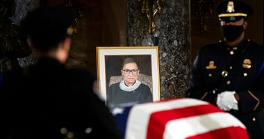 The flag-draped casket of Justice Ruth Bader Ginsburg lies in state in the U.S. Capitol on Friday, Sept. 25, 2020. (Erin Schaff/The New York Times via AP, Pool)