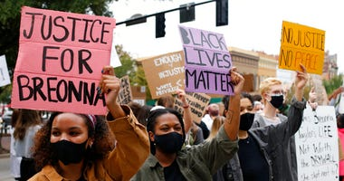 University of Georiga students lead a Black Lives Matter protest in downtown in memory of Breonna Taylor in Athens, Ga., Friday, Sept. 25, 2020. (Joshua L. Jones/Athens Banner-Herald via AP)