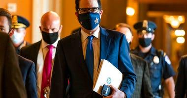 Treasury Secretary Steven Mnuchin, walks from the office of Senate Majority Leader Sen. Mitch McConnell of Ky., as he leaves the Capitol, Wednesday, Sept. 30, 2020, in Washington. (AP Photo/Manuel Balce Ceneta)