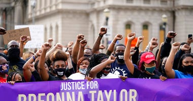In this Sept. 25, 2020, file photo, Black Lives Matter protesters march in Louisville. (AP Photo/Darron Cummings, File)