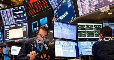 In this March 16, 2020 file photo, trader Gregory Rowe works on the floor of the New York Stock Exchange at the end of the trading day. (AP Photo/Craig Ruttle, File)