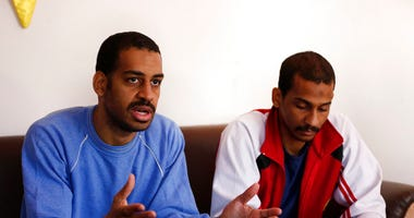 FILE - In this March 30, 2019, file photo, Alexanda Amon Kotey, left, and El Shafee Elsheikh, who were allegedly among four British jihadis who made up a brutal Islamic State Speak during an interview with The Associated Press. (AP Photo/Hussein Malla,Fi)
