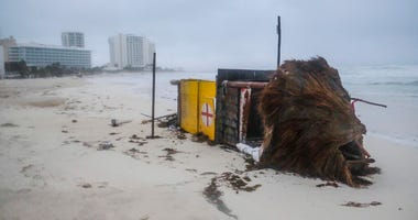 A lifeguard tower lays on its side after it was toppled over by Hurricane Delta in Cancun, Mexico, early Wednesday, Oct. 7, 2020. (AP Photo/Victor Ruiz Garcia)