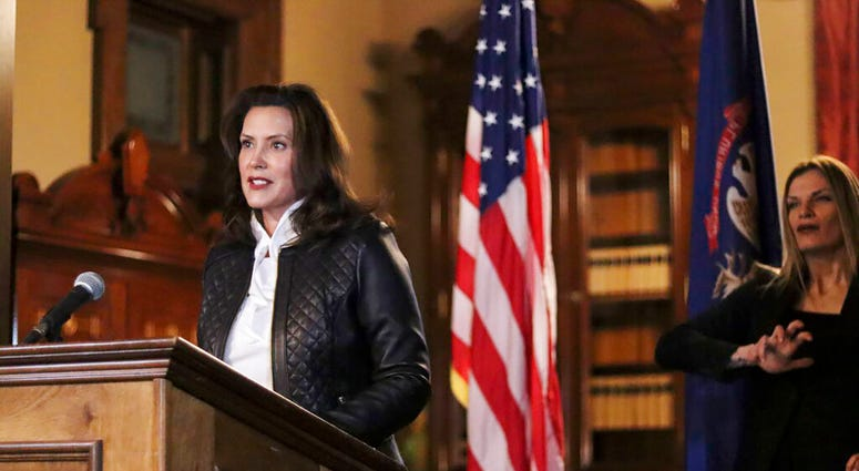 In a photo provided by the Michigan Office of the Governor, Michigan Gov. Gretchen Whitmer addresses the state during a speech in Lansing, Mich., Thursday, Oct. 8, 2020. (Michigan Office of the Governor via AP)