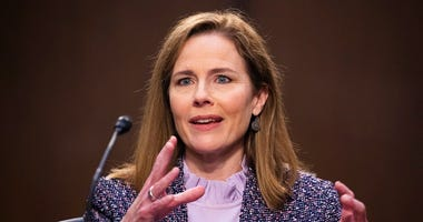 Supreme Court nominee Amy Coney Barrett speaks during a confirmation hearing before the Senate Judiciary Committee, Wednesday, Oct. 14, 2020, on Capitol Hill in Washington. (Michael Reynolds/Pool via AP)