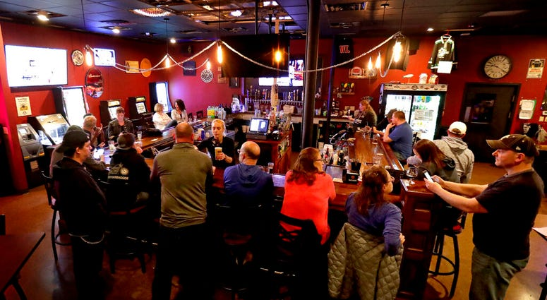 In this May 13, 2020 file photo, The Dairyland Brew Pub opens to patrons in Appleton, Wis. (William Glasheen/The Post-Crescent via AP File)