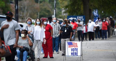 In this Oct. 12, 2020, file photo, voters wait in line to cast their ballot early at the Bell Auditorium in Augusta, Ga. (Michael Holahan/The Augusta Chronicle via AP, File)