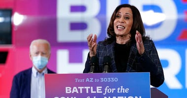 In this Oct. 8, 2020, photo, Democratic vice presidential candidate Sen. Kamala Harris, D-Calif., speaks at Carpenters Local Union 1912 in Phoenix, as Democratic presidential candidate former vice president Joe Biden listens. (AP Photo/Carolyn Kaster)