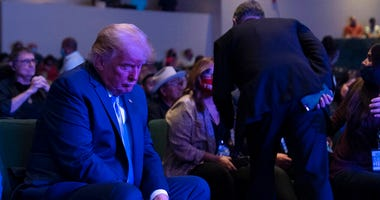 President Donald Trump prepares his offering as he attends church at International Church of Las Vegas, Sunday, Oct. 18, 2020, in Las Vegas, Nev. (AP Photo/Alex Brandon)