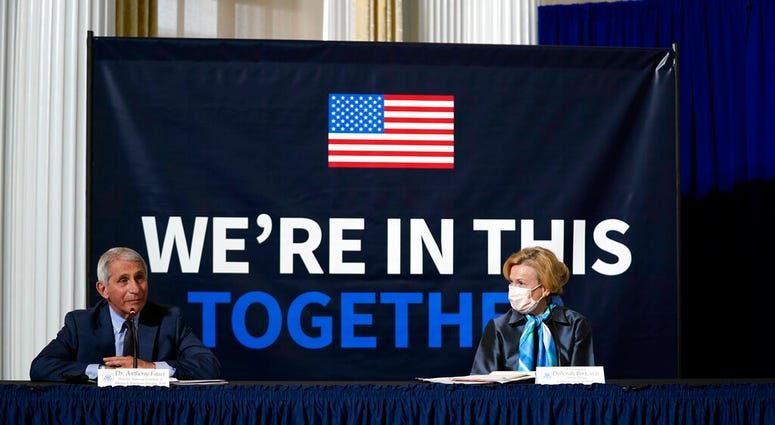 In this July 30, 2020, file photo, White House coronavirus response coordinator Dr. Deborah Birx, right, listens as Dr. Anthony Fauci, director of the National Institute of Allergy and Infectious Diseases, speaks. (AP Photo/Evan Vucci, file)
