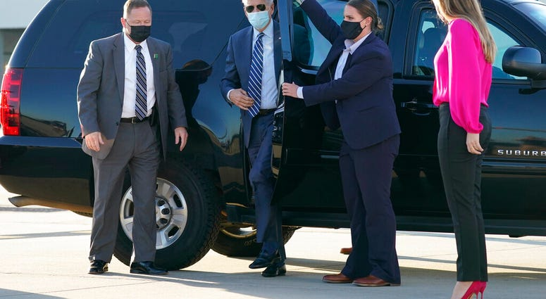In this Oct. 18, 2020, photo, Democratic presidential candidate former Vice President Joe Biden steps out to board his campaign plane at Raleigh-Durham International Airport in Morrisville, N.C. (AP Photo/Carolyn Kaster)