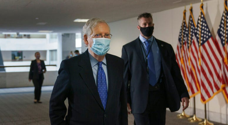 Senate Majority Leader Mitch McConnell, R-Ky., arrives for a closed-door meeting with Senate Republicans, on Capitol Hill in Washington, Friday, Oct. 23, 2020. (AP Photo/J. Scott Applewhite)