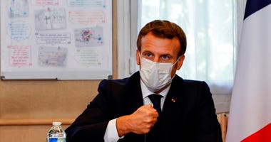 French President Emmanuel Macron chairs a meeting with the medical staff of the Rene Dubos hospital center, in Pontoise, outside Paris, Friday Oct. 23, 2020. (Photo by Ludovic Marin, Pool via AP)