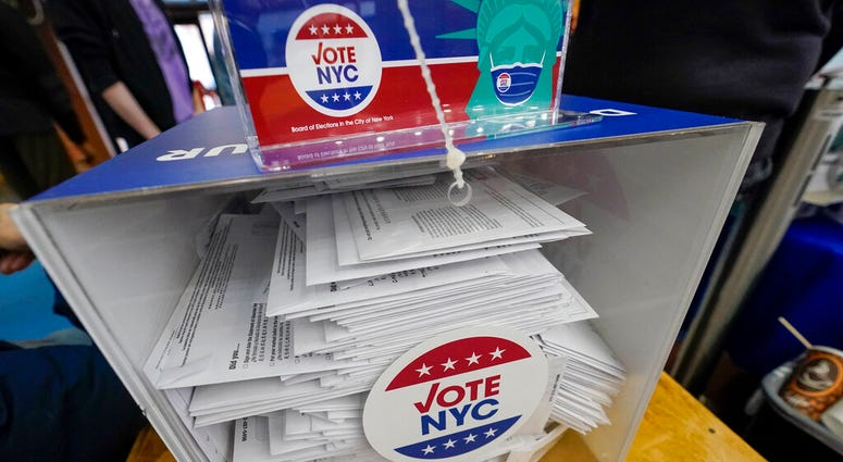 Absentee ballots are seen in a locked ballot box during early voting at the Park Slope Armory YMCA, Tuesday, Oct. 27, 2020, in the Brooklyn borough of New York. (AP Photo/Mary Altaffer)