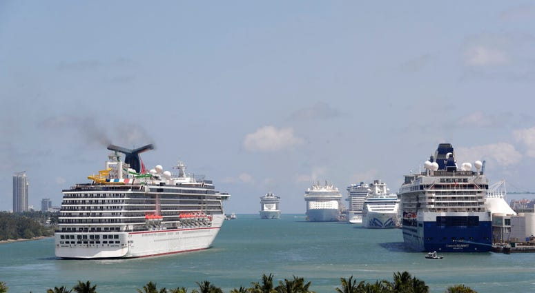 The Carnival Pride cruise ship arrives at PortMiami, Tuesday, April 7, 2020, in Miami. (AP Photo/Lynne Sladky)