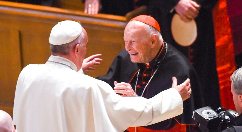 In this Sept. 23, 2015 file photo, Pope Francis reaches out to hug Cardinal Archbishop emeritus Theodore McCarrick at the Cathedral of St. Matthew the Apostle in Washington. (Jonathan Newton/The Washington Post via AP, File)