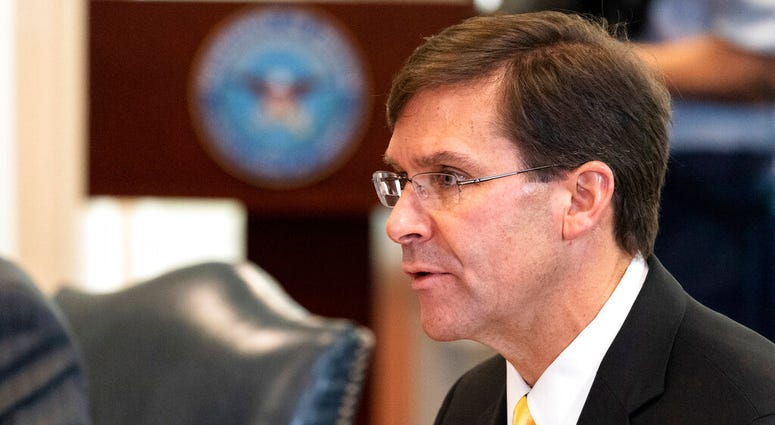 In this Oct. 8, 2020, file photo, Secretary of Defense Mark Esper speaks before a meeting with Romanian Defense Minister Nicolae Ciuca, at the Pentagon, in Washington. (AP Photo/Alex Brandon, File)