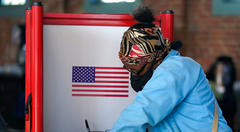 In this Tuesday, Nov. 3, 2020, file photo, Johnea Barlow casts her ballot at the Kentucky Center for African American Heritage, on Election Day in Louisville, Ky. (AP Photo/Darron Cummings, File)