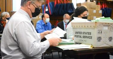 Election Bureau Director Albert L. Gricoski, left, opens provisional ballots alongside election bureau staff Christine Marmas, right, in Pottsville, Pa. on Tuesday, Nov. 10, 2020. (Lindsey Shuey/The Republican-Herald via AP)