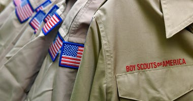 FILE - In this Feb. 18, 2020, file photo, Boy Scouts of America uniforms are displayed in the retail store at the headquarters for the French Creek Council of the Boy Scouts of America in Summit Township, Pa.  (Christopher Millette/Erie Times-News via AP,