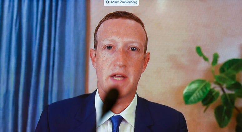 Facebook CEO Mark Zuckerberg testifies remotely during a Senate Judiciary Committee hearing on Facebook and Twitter's actions around the closely contested election on Tuesday, Nov. 17, 2020, in Washington. (Hannah McKay/Pool via AP)