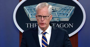 In this Tuesday, Nov. 17, 2020, image taken from a video provided by Defense.gov Acting Defense Secretary Christopher Miller speaks at the Pentagon in Washington. (Defense.gov via AP)