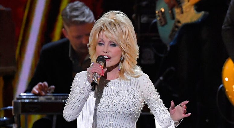 FILE - In this Nov. 13, 2019 file photo, Dolly Parton performs at the 53rd annual CMA Awards in Nashville, Tenn.  (AP Photo/Mark J. Terrill, File)