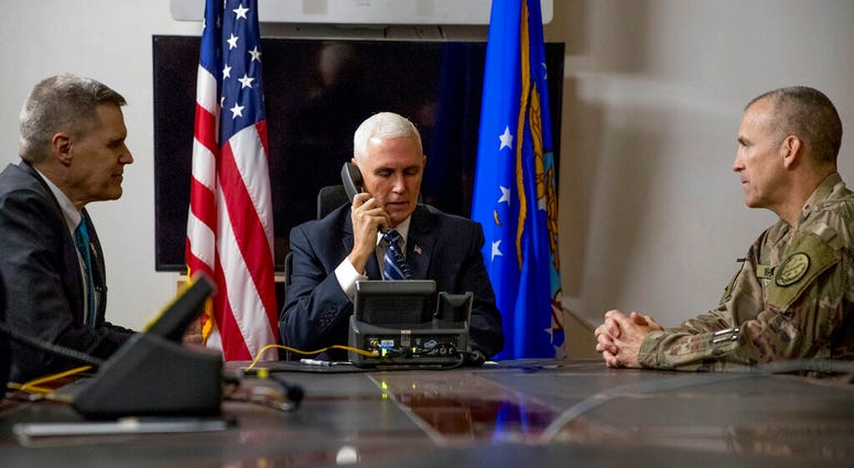 File photo Vice President Mike Pence, accompanied by U.S. Ambassador to Iraq Matthew Tueller, left, and Lt. Gen. Pat White, right, takes a phone call with Iraqi Prime Minister Adil Abdul-Mahdi at Al Asad Air Base, Iraq. (AP Photo/Andrew Harnik, File)