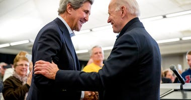 FILE - In this Feb. 1, 2020, file photo Democratic presidential candidate former Vice President Joe Biden smiles as former Secretary of State John Kerry, left, takes the podium to speak.  (AP Photo/Andrew Harnik, File)