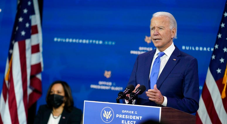 President-elect Joe Biden speaks as Vice President-elect Kamala Harris listens at left, during an event to introduce their nominees to economic policy posts at The Queen theater, Tuesday, Dec. 1, 2020, in Wilmington, Del. (AP Photo/Andrew Harnik)