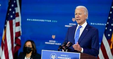President-elect Joe Biden speaks as Vice President-elect Kamala Harris listens at left. (AP Photo/Andrew Harnik)