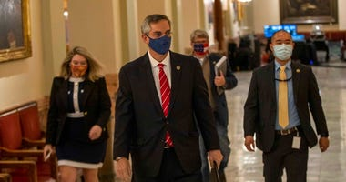 Georgia Secretary of State Brad Raffensperger, center, walks with members of his staff as they make their way to a press conference at the Georgia State Capitol building in Atlanta.  (Alyssa Pointer/Atlanta Journal-Constitution via AP)