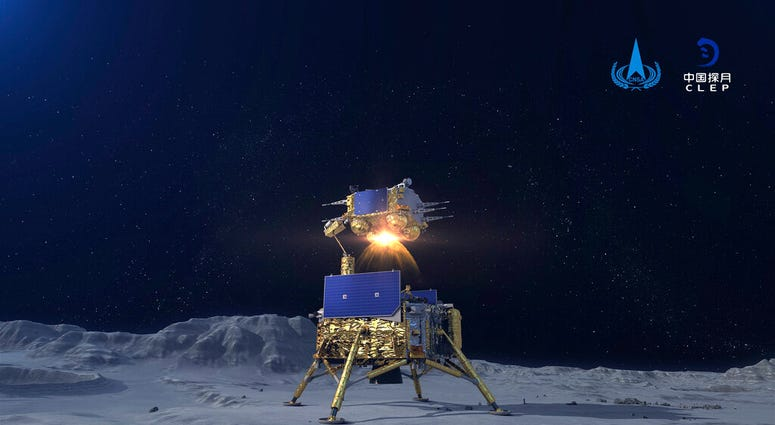 In this China National Space Administration (CNSA) photo released by Xinhua News Agency, a simulated image of the ascender of Chang'e-5 spacecraft blasting off from the lunar surface at the Beijing Aerospace Control Center (BACC) in Beijing on Dec. 3, 202