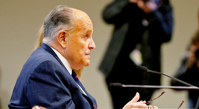 Rudy Giuliani, President Donald Trump's personal attorney, testifies during a Michigan House Oversight Committee hearing for suspicion of voter fraud within the state at the House Office Building in Lansing, Mich., on Wednesday, Dec. 2, 2020.