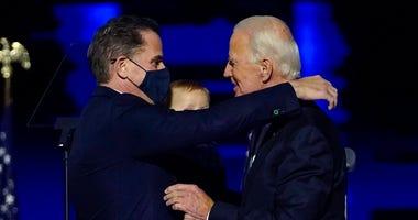 In this Nov. 7, 2020, file photo, Presidenet-elect Joe Biden, right, embraces his son Hunter Biden, left, in Wilmington, Del. (AP Photo/Andrew Harnik, Pool)