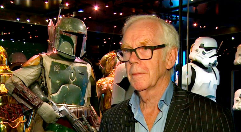 "Jeremy Bulloch speaks in front of the costume he wore while playing Boba Fett in ""Star Wars: Episode V – The Empire Strikes Back"" and ""Star Wars: Episode VI – Return of the Jedi"" at the Star Wars Identities exhibition in London"