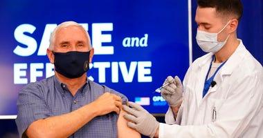 Vice President Mike Pence receives a Pfizer-BioNTech COVID-19 vaccine shot at the Eisenhower Executive Office Building on the White House complex, Friday, Dec. 18, 2020, in Washington.