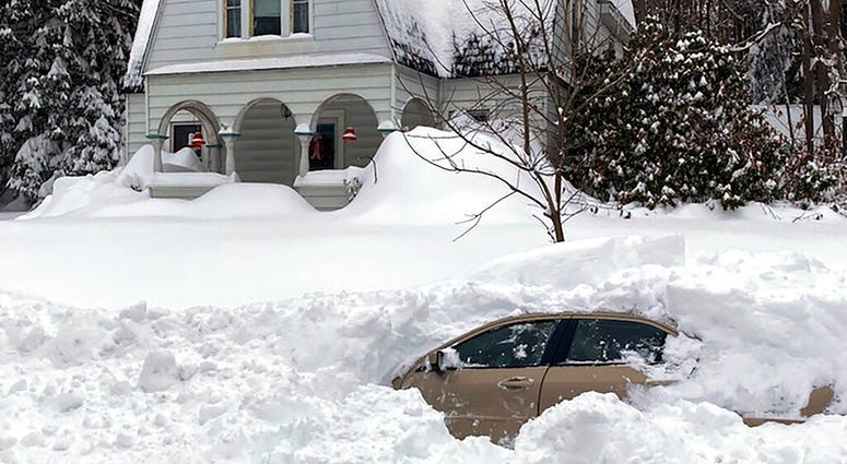 This photo, provided by the New York State Police, shows a car, in Owego, NY, from which a New York State Police sergeant rescued Kevin Kresen, 58, of Candor, NY, stranded for 10 hours