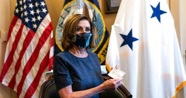 Speaker of the House Nancy Pelosi, D-Calif., sits after receiving a Pfizer-BioNTech COVID-19 vaccine shot in Washington, Friday, Dec. 18, 2020.