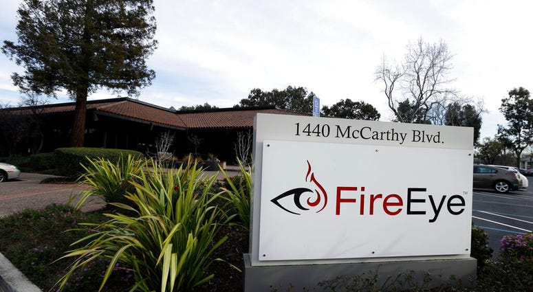 FILE - This Wednesday, Feb. 11, 2015 file photo shows FireEye offices in Milpitas, Calif. Experts say it's going to take months to kick elite hackers widely believed to be Russian out of U.S. government networks.