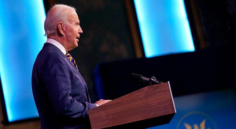 President-elect Joe Biden speaks at The Queen theater, Tuesday, Dec. 29, 2020, in Wilmington, Del. (AP Photo/Andrew Harnik)