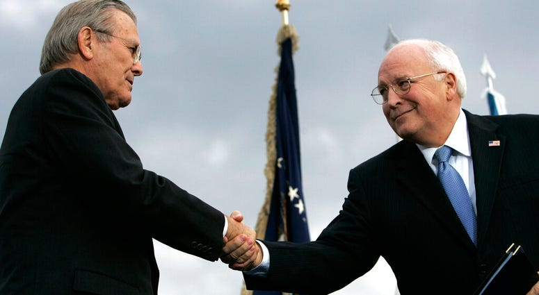 In this Dec. 15, 2006, file photo, outgoing Defense Secretary Donald H. Rumsfeld, left, shakes hands with Vice President Dick Cheney during an Armed Forces Full Honor Review for Rumsfeld at the Pentagon. (AP Photo/Pablo Martinez Monsivais, File)