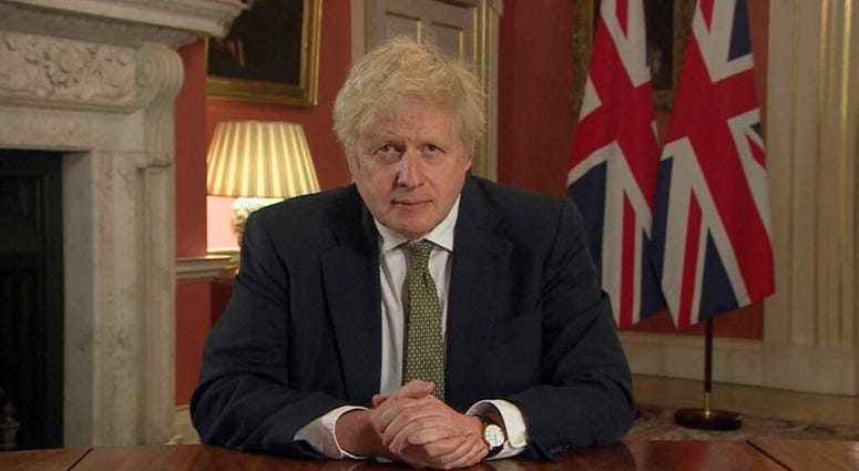In this image taken from video, Britain's Prime Minister Boris Johnson makes a televised address to the nation from 10 Downing Street, London, Monday Jan. 4, 2021. (Pool via AP)