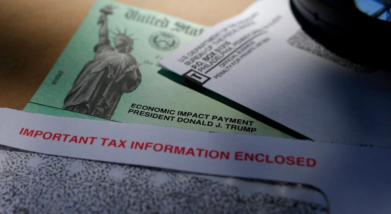 FILE - In this April 23, 2020, file photo, President Donald Trump's name is seen on a stimulus check issued by the IRS to help combat the adverse economic effects of the COVID-19 outbreak, in San Antonio.