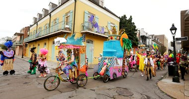 FILE - In this Tuesday, Feb. 25, 2020, file photo, Mondo Kayo parades down Chartres Street during Mardi Gras, in New Orleans.  (AP Photo/Rusty Costanza, File)